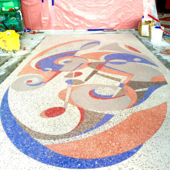 Art Deco style terrazzo floor process after a design by muralist Georgeta Fondos with musical notes and musical instruments Performing Arts Center of Lauderhill