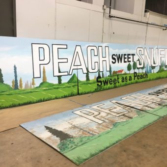 Mural painted anew, mural on wood panels, a mural for the Coral Springs historic covered bridge, peach sweet snuff mural, sweet as a peach mural, historic mural with peach sweet snuff, mural on wood